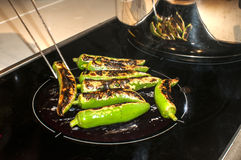 Green chilies on hot plate Royalty Free Stock Photos