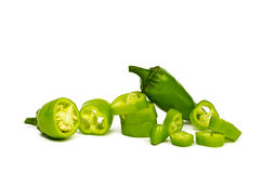 Green Chilli Peppers (Jalapeno). Hot green Jalapeno, sliced and whole, kept on white background Royalty Free Stock Photos