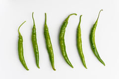 Green chilli peppers ob white background Royalty Free Stock Images