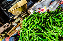 Green chilli, Rajasthan, India. Pile of green chilli and old weight scale Stock Photography