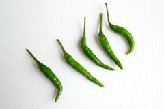 Green Chilli in row Royalty Free Stock Images