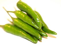 Green Chillies. Green Finger Chillies on a white background Royalty Free Stock Image