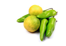 Green chillies and lemon. Isolated on white background Stock Photography