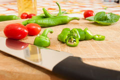 Green chillies. Photographed on chopping board Stock Photography