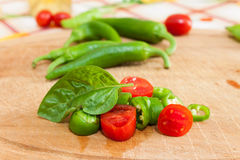 Green chillies. Photographed on chopping board Royalty Free Stock Photography