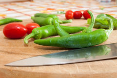 Green chillies. Photographed on chopping board Stock Photo