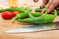 Green chillies. Photographed on chopping board Stock Photos