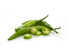 Green chillies on white background Stock Photos