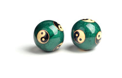 Green Chinese balls for relaxation on the white Royalty Free Stock Photos