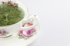 Green chinese tea in the cup Royalty Free Stock Photos