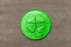 Green chocolate coin with four-leaf clover Stock Photo
