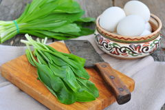 Green chopped eggs salad with potato, ramson and parmesan cheese Stock Photos