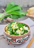 Green chopped eggs salad with potato, ramson and parmesan cheese Royalty Free Stock Photos