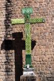 Green Christian Cross With Light Bulbs Peru. Green Christian Cross Before Stone Wall Of Church Peru stock image