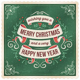 Green Christmad Card with Ribbons and Floral Ornaments Stock Photography