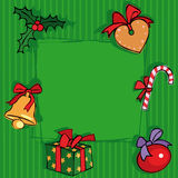 Green Christmas background. With gift, bell and gingerbread Stock Photos