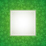 Green christmas background. With snowflakes Stock Photos