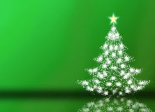 Green christmas background. Image of glowing Christmas tree over green Stock Images