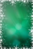 Green Christmas background. With white snowflakes Stock Images