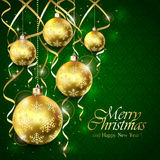 Green Christmas background with balls and golden tinsel Stock Image