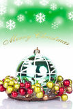 Green christmas background - card. Green xmas ball with text above merry christmas Royalty Free Stock Images
