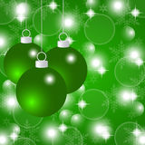 Green Christmas background with Christmas balls. And snowflakes Stock Photography