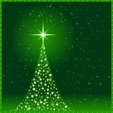 Green Christmas background With Christmas tr. Square green christmas card showing a Christmas tree made of shiny stars with a glowing tree top star and snowfall Stock Photo