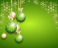 Green christmas background decorated with christmas bulbs. Green christmas background decorated with golden christmas bulbs and snowflake decoration Stock Photo