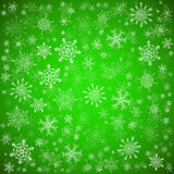 Green Christmas background with different snowflakes Stock Image
