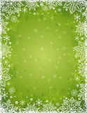 Green christmas background with  frame of snowflakes and stars Stock Images