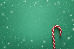 Green Christmas background with red candy canes. Copy space for text. Green Christmas background with red candy canes. Top view, flat lay. Copy space for text Royalty Free Stock Photo