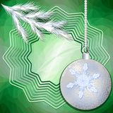 Green christmas background with silver ball and frosted branch Stock Photos
