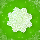 Green Christmas background with snowflake Stock Images