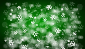 Green christmas background. With snowflakes and bokeh Royalty Free Stock Images