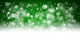 Green christmas background. With snowflakes and bokeh Stock Photos