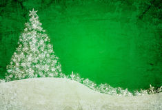 Green christmas background. With snowflakes and pine tree Stock Photography