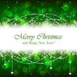 Green Christmas background with snowflakes and stars Stock Images