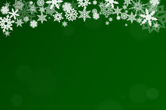 Green christmas background. With snowflakes in winter Royalty Free Stock Image