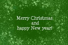 Green Christmas background. With white snowflakes and snow, text merry Christmas and happy new year Stock Images
