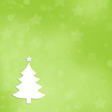 Green christmas background with a white tree. Stock Image
