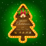 Green Christmas background with wooden banner Stock Image
