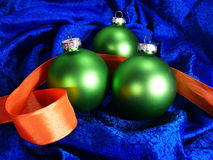 Green christmas ball. On blue silk background Stock Image