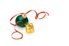 Green Christmas Ball. Green Christmas Bauble with a red ribbon and present Stock Photography
