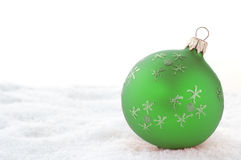 Green Christmas Ball. On snow. Isolated on white Stock Images