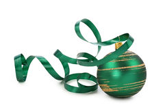 Green christmas ball. With a curly ribbon isolated on white background Stock Images