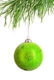 Green christmas ball on pine branch royalty free stock image