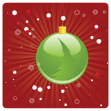Green Christmas ball on red background Royalty Free Stock Photos