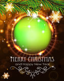 Green Christmas ball with sparkles and fir branches Royalty Free Stock Image