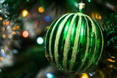 Green christmas ball on a spruce branch. New year Royalty Free Stock Photography
