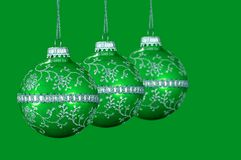 Green Christmas Balls. With Green background stock photos
